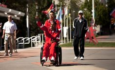 Marine Wounded Warriors carry the torch at the Warrior Games Opening Ceremony (U.S. Marine Corps photo by Lance Cpl. Chelsea Flowers)