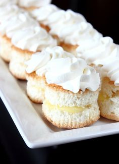 Angel food cupcakes sandwiched with a homemade lemon curd and topped with lightly sweetened whipped cream.