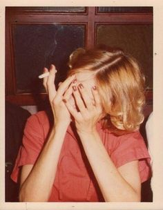 I like the cigarette and hands covering face like she's crying