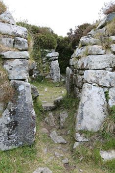 Chysauster Village, Cornwall, is a late Iron Age and Romano-British village of courtyard houses, which is currently in the care of English Heritage. Devon And Cornwall, Cornwall House, Roman Britain, English Heritage, Iron Age, Wanderlust, British Isles, Great Britain, Places To See