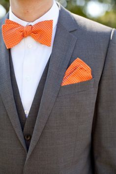 Gray suit, orange bow tie