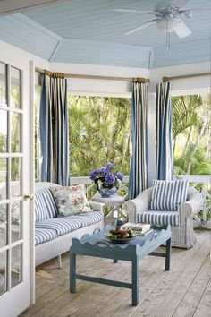 what a patio - these blue stripes are great on the fabric. 25 Coastal And Beach-Inspired Sunroom Design Ideas | DigsDigs