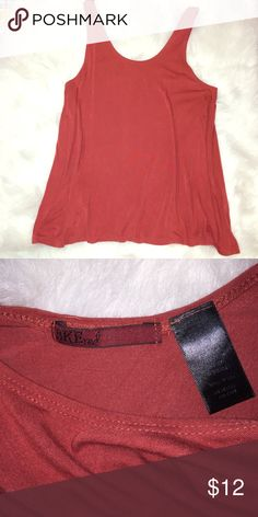 BKE Red Relaxed & Flowy Tank from Buckle BKE Relaxed & Flowy Tank from Buckle. Size Large. Stretchy and super comfy. Only worn twice. In excellent condition. Color is a deep dark red. Buckle Tops Tank Tops