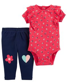 Crafted in soft cotton and lots of love, this 2-piece set features a floral printed bodysuit and sweet knee art to keep her cute and colorful!