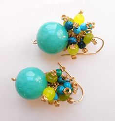 Greenery burst earrings, gemstone cluster earrings, made with green jade round beads, blue green chrysocolla beads, turquoise faceted beads & lime jade beads. A colorful, playful, feminine pair of earrings featuring big green jade round beads adorned with clusters of turquoise faceted beads, green blue chrysocolla beads, lime jade faceted beads and light green jade faceted rondelles. These earrings bring me in mind a day of sunshine lying in the spring green fields. . So lovely! The wire ...