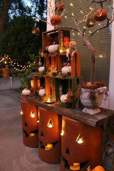 fun jack o lanterns cozy fall patio decorating ideas nested crates and pottery pumpkins with led candles and string lights would make your outdoor area