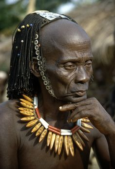 Lusolo, a lutumbo lwa kindi, wearing hat known as sawamazembe, near Kalima, Congo (Democratic Republic). Photo Eliot Elisofon, ca. 1967.
