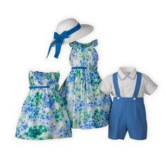 Hues of blues and greens splashed against a white background. Pin-tucked pleated bodices with ruffled collars. Cornflower blue ribbon with floral pin at waistlines finish to tie back sashes. Button backs. Attached slips. Cotton organza. Below knee. Hand wash. Imported.A WOODEN SOLDIER exclusive.
