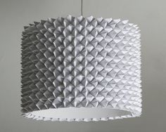Constructed from hundreds of folded fortune tellers formed around a pre-existing plastic Lobbo lamp shade from Ikea