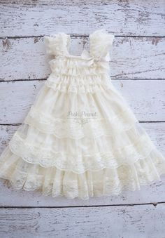 Ivory Baby doll dress! STunning lace ruffle cap sleeves with ruffle lace top. Chiffon bodice is made with 3 trim french lace! Adorned with satin