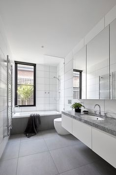 House in Melbourne by Tom Robertson Architects « white and grey modern bathroom, floating vanity, face storage behind mirrors Grey Modern Bathrooms, Gray And White Bathroom, White Vanity Bathroom, Large Bathrooms, Modern Bathroom Design, Bathroom Interior Design, Decor Interior Design, Bathroom Vanities, Bathroom Cabinets