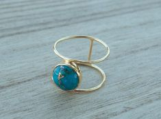 Beautiful double thin band ring in Gold Vermeil. The center stone cut in circle is the Turquoise hand-mixed with copper. This everyday ring is our most popular design and our best-seller! Features: ✔️ The base of the ring is made in GOLD VERMEIL: Gold vermeil, or just vermeil, refers