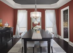 Benjamin Moore Paint Colors - Red Dining Room Ideas - Intensely Red Dining Room - Paint Color Schemes . . . . . Rich Moroccan Spice is earthy and slightly exotic. . . . . . Walls - Moroccan Spice (AF-285); Ceiling - Stormy Sky (1616); Trim - Distant Gray (2124-70).