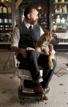 Russell Manley and Daisy sit at Tommy Guns Salon. © Crain Communication