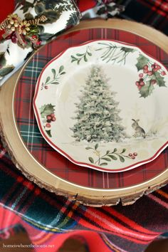 Christmas table with tartan, greenery and Fitz and Floyd bunnies | homeiswheretheboatis.net #tablescape #plaid