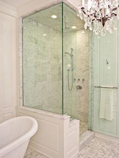 PLD Custom Homes - bathrooms - walk in shower, glass shower, glass walk in shower, seamless glass shower, rain shower head, marble shower surround, paneled shower, claw foot bathtub, bathtub chandelier, master bathroom chandeliers,