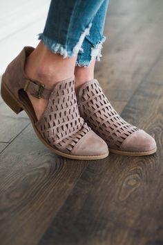 The taupe booties will be sure to match just about any outfit! It features a solid, closed toe and solid back that is attached by two elastic straps to a panel that has a cute triangle pattern cutout