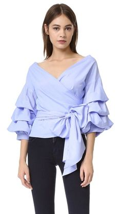 Wrap Top with Layered Ruffles at the 3/4 Bishop Sleeves. 100% Polyester. Length: 53 cm from shoulder (size M) (One by Stylekeepers Modern Vintage Top)