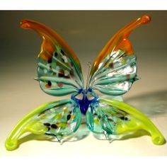 Green with Red Glass Butterfly Ornament $26.95 http://www.glasslilies.com/182-green-with-red-glass-butterfly-ornament-.html #Green #Red #Glass #Butterfly #Ornament  #BlownGlass #GlassArt #Gifts #Figurine