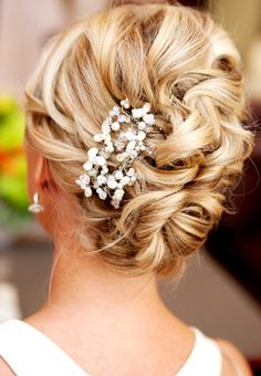 Your blonde hair will radiate in a gorgeous updo showing off your summer highlights.