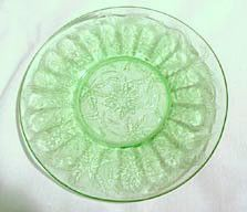 These are 6 inch Depression glass sherbet plates in the green Floral pattern. They were made by the Jeannette Glass Co 1931-1935. They are in nice condition with no chips or cracks.