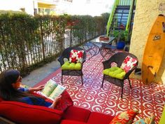 Designers at Design Vidal created an outdoor carpet at this East Hollywood apartment complex using a hand-cut stencil.