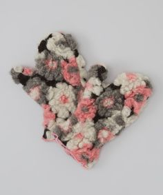 adorable mittens. Their floral design blooms with style no matter the weather, and fleecy construction keeps precious fingertips toasty-warm.43% polyester / 42% acrylic / 15% woolMachine wash; hang dryImported