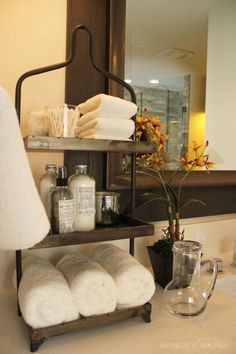 Use stackable trays in your bathroom to keep essentials tidy. See more decor ideas at Happiness is Homemade.