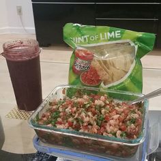 Homemade bayshrimp salsa with kale shake (kale blueberries banana and orange juice) and cheating a littlw with tostitos chips.  Trying to keep my diet clean for a good shred.  That fit life tho.  #fit #lowcarb #gain #tryingtoshredthefuckup #leangains #foodporn by ironfanatic