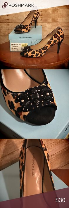 """Leopard Print Open Toe Heels These Leopard print open toe heels look great with everything! With a 1 1/2"""" heel, they are not too high-so you can wear them longer! The material of the leopard is like hair (not really sure what else to call it!). The toes are adorned with jewels-all accounted for in these lovelies! Worn once for a meeting in the city, so the soles show how far I had to walk, but the tops are in pristine condition! SEXY, COMFORTABLE, and original box included! ANTONIO MELANI…"""