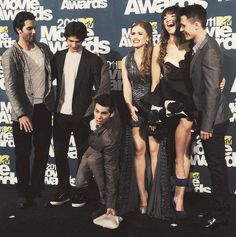 Dylan is totally picking up Holland's purse for her. That is so sweet.