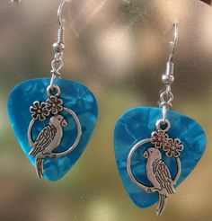 Parrot Guitar Pick Earrings- Your Choice Color. $6.00, via Etsy.