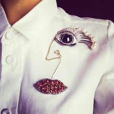 """Portrait"" in Paris. Wearing the Portrait brooch during the Couture Fashion Week. from : Delfina Delettrez"