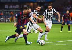 Lionel Messi of Barcelona takes on Leonardo Bonucci and Andrea Barzagli of Juventus during the UEFA Champions League Final between Juventus and FC Barcelona at Olympiastadion on June 6, 2015 in Berlin, Germany.