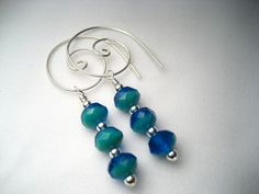 I have a weird thing about those plain, ugly hooks that hold earrings on.  Love these!