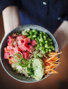 "There's no raw fish in these ""poke"" bowls. These colorful concoctions are made with brown rice, edamame, ginger-marinated beets, julienned vegetables, and a drool-worthy avocado wasabi cream. Get the recipe. Lunch Recipes, Vegetarian Recipes, Healthy Recipes, Clean Eating, Healthy Eating, Avocado Cream Sauces, Cauliflower Risotto, Quinoa Breakfast Bowl, New Roots"