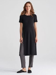 The high-slit tunic. A not-so-basic layer that adds drama to pants and dresses.