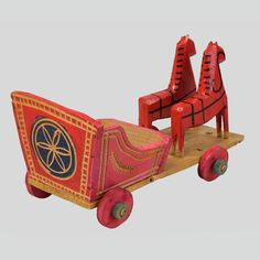 Toy horse-drawn carriage. Wooden horses and carriage mounted on a platform on wheels. Polichromy, engraved. Herringbone pattern on the side of the carriage, and a rosette on the back.  Lachowice, P. Sucha Beskidzka, 1972