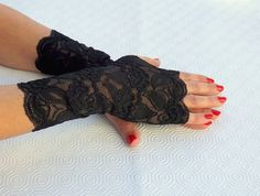 Black lace fingerless gloves. Elastic floral by AtufaAccessories
