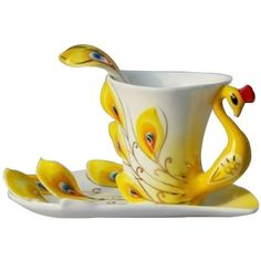 Amazon.com   Leegoal Yellow Peacock Tea Coffee Cup and Saucer: Tea... (94 HRK) ❤ liked on Polyvore featuring home, kitchen & dining, drinkware, coffee cup saucer, coffee cups and saucers, tea cup saucer and tea cups and saucers