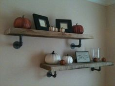 floating shelves supported by pipes. industrial and functional