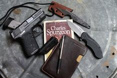 Here's some of today's EDC gear dump: Smith & Wesson M&P Shield (get the Talon grips here) Penny Face Knives Neck Knife Kershaw Folder Knife (same one here, only with serations) PFK Leather Pocket, Field Notes Notebook (I get this three pack) 5.11 Tactical EDC Flashlight Charles Spurgeon biography(I can't find the exact book, but lots of Spurgeon biographies here)