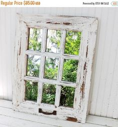 This is as rustic as they come!!! Great farmhouse look with this antique style reproduction window pane mirror..I have refinished it in a white