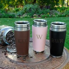 Whether they like their coffee steaming hot or ice cold, they'll love this Personalized Executive Travel Tumbler. This classy travel mug features a leather-look exterior with attractive edge stitching and is available in three rich colors.  Great for the office, home, or on the road, the mug includes a sturdy cap and stainless accents. The soft vinyl cuff is removable for easy washing.  Holds 14 ounces. Select from brown, pink or black.