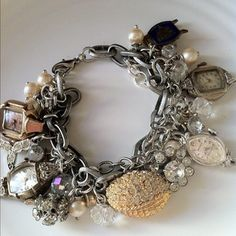 I absolutely love this bracelet......the rhinestones, beads and pearls and those wonderful watch cases.