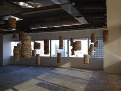 Mental Notes, Susan Benarcik, book pages, copper wire, 32 piece installation