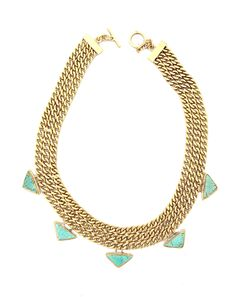 - Brass statement necklace - Braided chain detail - Triangle turquoise pendants - Toggle closure RESPONSIBILITY All of Cleobella's products are made by hand in Bali. We are committed to sustainable ma