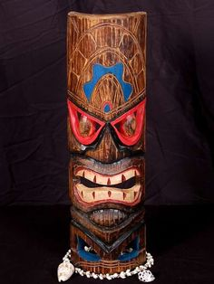 """Here is a hand carved Tiki mask with a beautiful finish. This Polynesian Tiki mask was hand carved with great attention to details (ready to hang!).  Measurement: 20"""" by 6 inches  Tiki: Polynesian Tiki"""