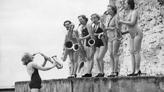 April 1938: A female saxophone band known as 'The Silver Sax Six' rehearsing at a South Coast resort. (Fox Photos/Getty Images)