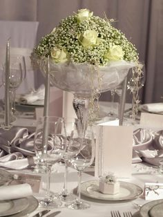 For absolute elegance, an all-white floral arrangement with gorgeous baby's breath draped over the side cannot be beat.